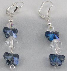 AB sapphire butterfly beads, silver plated round beads, and bicone crystal beads create this dangle earring set.