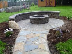 Interlocking paver fire pit surround and stone pathway designed and installed in Eugene, Oregon by Graham Landscape and Design