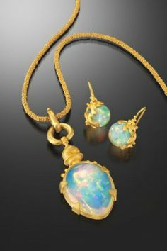 Created by Lilly Fitzgerald, this hand-fabricated necklace and matching earrings feature Ethiopian opals in salt gold.