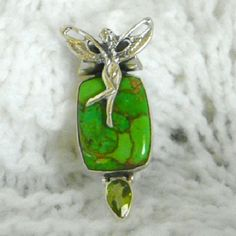 "925 green copper turquoise fairy pendant Beautiful green copper turquoise set in sterling silver adorned with a peridot and frolicking fairy. Tubular bail partialy hidden by the fairy. 12.93 cts, 1 5/8"" in length. Made in India.  No trades. Jewelry Necklaces"