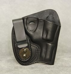 Inside the Waistband Leather Holster for Ruger LCR. Holster comes in black or brown and has ambidextrous capability (left or right hand draw). The clip can be removed and placed on the opposite side of the holster for left hand draw or small of back carry. $54.99 #holster #gunholster #concealedcarry #IWB #Ruger #RugerLCR #LCR Gun Holster, Leather Holster, Holsters, Concealed Carry, How To Draw Hands, Wallet, Brown, Guns, Shops