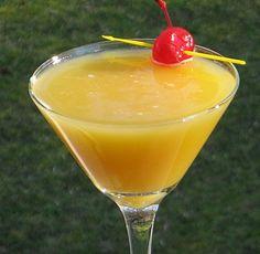 Bermuda Triangle Martini    (.5 oz. Citrus Vodka  .5 oz. Peach Schnapps  .5 oz. Amaretto  .5 oz. Banana Schnapps  2 oz. Pineapple Juice  2 oz. Orange Juice  Cherry for garnish)