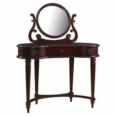 """Wood vanity in brown with 3 drawers and a center mirror.    Product: Vanity tableConstruction Material: Wood and mirrored glassColor: Vintage mahoganyFeatures: Three drawersDimensions: 50"""" H x 40"""" W x 18"""" D (overall)"""