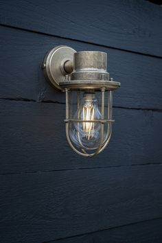 The Bulkhead Outdoor Light is a handsome garden wall light, hand cast in solid, natural brass, with a light antique finish and a robust and practical styling that is reminiscent of shipping and industrial days gone by. Conduit Lighting, Jim Lawrence Lighting, Garden Wall Lights, How To Clean Brass, Modern Rustic Homes, External Lighting, Natural Building, Hand Cast, Outdoor Wall Lighting