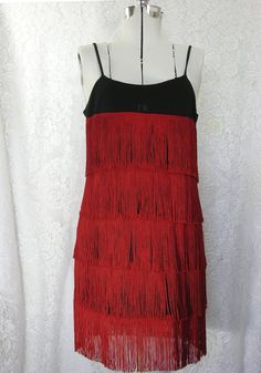 Red and black fringed flapper dress 1920s costume or dancing dress. $52.00, via Etsy.