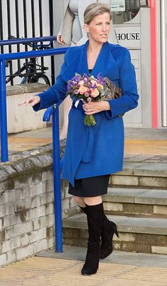 Sophie, Countess of Wessex, dazzled in an electric blue coat and knee-high black boots as she conducted four engagements in the West Country on 23.10.13.