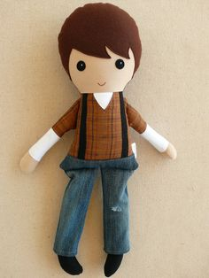 Reserved for Nicole:    This is a handmade cloth doll measuring 20 inches. He is wearing a rugged brown plaid shirt with a white long-sleeved
