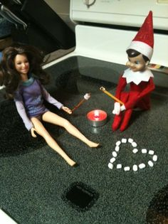 Elf on the shelf - sharing the love roasting marshmallows with barbie