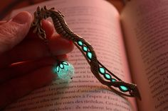 Glow-in-the-Dark Bookmarks Complement Fantastical Tales with a Mystical Turquoise Light - My Modern Met