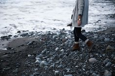 sorel boots with socks and jeans on beach
