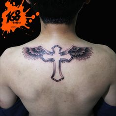 Cross tattoo and wing black and grey