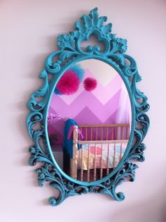 Turquoise antique mirror & pink chevron baby girls room with tulle poms