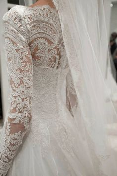 I like the idea of paisley lace. Detailed Lace Paisley Wedding Gown with Long Sleeves #paisleywedding #paisleydress