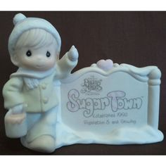 Enesco's Precious Moments Sugar Town Village - Sam Butcher Painting Sign Figurine - Signed 1992 G-Clef 529567 NIB || Available for sale via the pin's link. To see our complete collection of Precious Moments available, check out our store under the Collectibles > Enesco > Precious Moments category at http://purpleiris.ecrater.com/c/1760136/precious-moments