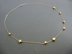 Gold Stars are hand wired on a 14K Gold filled Chain Ramdomly. Great gift for Teacher, sister, mother and best friend who are your inspriataion.   **Let