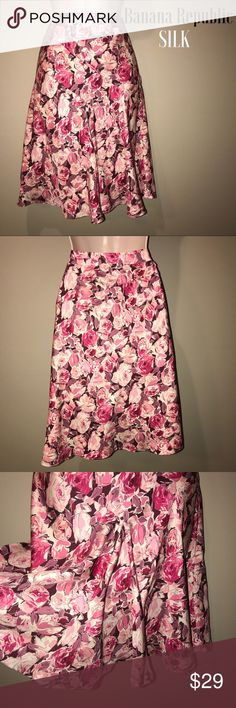 Banana Republic 100% Silk skirt, size 4 Beautiful Roses Print Skirt in 100% silk.  Fully lined.  Has an extra gather of fabric pleat in front to give it movement.  Fully lined and in excellent preowned condition.  Size is 4 Banana Republic Skirts