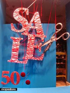 Sale sign with yarn window display Window Display Design, Store Window Displays, Retail Displays, Visual Merchandising Displays, Visual Display, Retail Windows, Store Windows, Store Concept, Vitrine Design