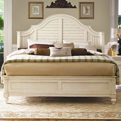 Arched panel bed with a louvered headboard.    Product: BedConstruction Material: WoodColor: Linen