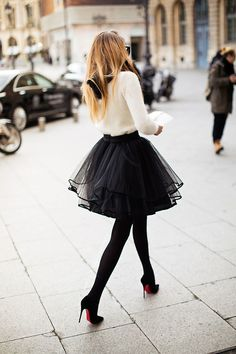 Louboutins + Fluffy Tulle Skirt + White sweater would not think this works but some people came make anything look good.