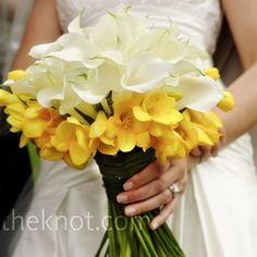 modern twist on the classic calla lily bouquet. The florist accented her favorite flower with a collar of yellow freesia.