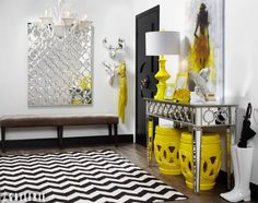 Make an entrance with color! This week, we will share one entryway styled in three signature spring hues. First, this cheerful entrance greets guests with electric yellow accessories and reflective surfaces