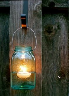 mason jar with floating candle. - Could get wreath over-the-door hangers on clearance after Xmas and just spray paint them all the same colors to hold the mason jars :)
