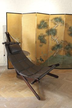 Low sling back lounge chair from the 70′s & room divider www.gallerygush.com