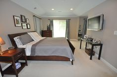 Contemporary Master Bedroom - Summit Gray Sherwin Williams, dark wood furniture