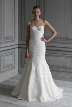 Monique Lhuillier - I absolutely love this dress, it's one of my favorites! The exact type of lace wedding gown I want...