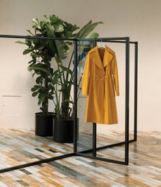 Inside the freshly renovated headquarters of French fashion house Céline: The main showroom features a marquetry floor made of 12 different types of marble sourced from France, Brazil and Italy. The coat is from the spring/summer 2015 collection. Design Despace, Store Design, Design Tech, Display Design, Boutiques, Celine, Cuir Orange, Style Work, Fashion Showroom