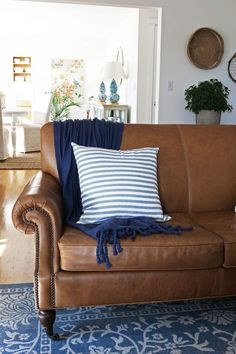 Image result for colour schemes to go with brown leather sofa