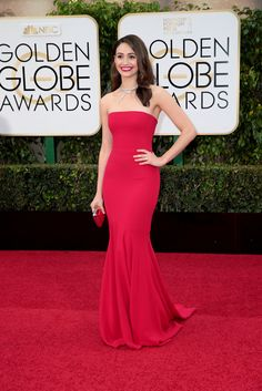 Emmy Rossum just stuns in a #ArmaniPrivé crimson red silk crepe strapless gown #goldenglobes2016