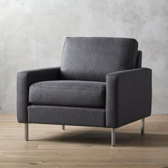 Shop central graphite chair.   Midcentury looks with modern comfort.  Tailored graphite weave suits a clean, linear silhouette topped with an oversized cushion that invites lounging.