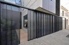 Modern Unpolished Home with Industrial Look: Incredible Fence Design With Glass Wall In Black Color Decoration With Modern Door Design Used Concrete Floor Decoration Ideas Design Café, Door Design, Exterior Design, House Design, Design Ideas, Modern Entrance Door, Modern Door, Concrete Wall, Concrete Floors