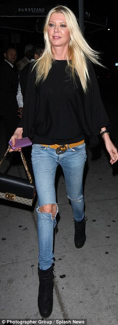 Making her mark: She teamed ripped jeans with heeled ankle boots and a Gucci bag...