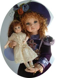 LUCY with friend. Limited Edition Porcelain Artist Original. Costumed in silk velvet with hand beaded trim. She has crystal paperweight eyes and mohair wig.