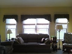 We designed the function of shades for privacy and contoured shirred on fabric valances to compliment the room...