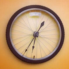 Bicycle tire clock.  Oh so adorable