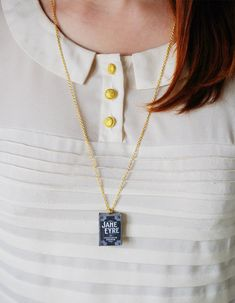 Lovely charm that holds a miniature book of Charlotte Brontës Jane Eyre. Handmade.