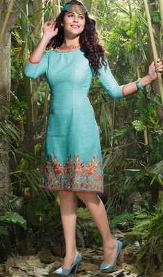 Flaunt your elegance of style, taste and manner dressed in this cyan blue linen embroidered tunic. The floral patch, lace and resham work appears to be chic and aspiration for any event.  #SexyClassicalTunicKurtis
