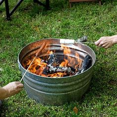 """Portable Fire Pit Idea/Backyard """"Campout"""" Party/Beach Fire-Haul your wood in the container then instant fire. How about putting the galvanized tub inside the rock or rock wall. Backyard Camping, Fire Pit Backyard, Backyard Landscaping, Backyard Kids, Backyard Seating, Landscaping Ideas, Camping Fire Pit, Backyard Beach, Wedding Backyard"""