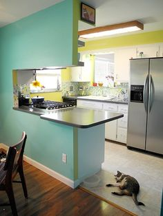 What makes your small kitchen so cool?  What makes this small kitchen cool is that it feels so big! When we remodeled, we used bright, mid-century colors, plain white cabinets and simple finishes that really compliment the rest of the house.