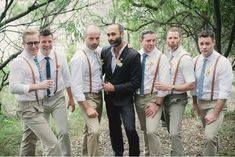 These groomsmen are stylish in their suspenders and unique ties. (Plus, check out their Zoolander faces!)