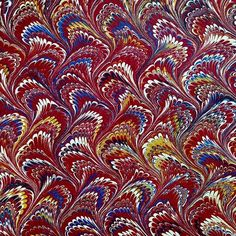 """This colorful feather-patterned marbled paper appears inside a rebound 1836 edition of """"United States Criminal History. Being a True Account of the Most Horrid Murderers, Piracies, High-Way Robberies etc., Together with the Lives, Trials, Confessions and Executions of the Criminals."""" With a title like that, we suspect that the end papers contain more joy than the 550 page text!  #aas_marbling #marbledmonday #marbling #rarebook"""
