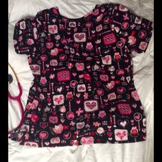 Valentine's Day Nursing Scrub Top. Size Medium Valentine's Day Nursing Scrub Top for the holiday. Size Medium. Good Condition. No stains, rips, etc. Fits like a 10-12. Runs Large. Two pockets in front. Tops Blouses