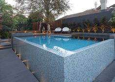 OFTB Melbourne landscape architecture, pool design & construction project - wet edge pool, bisazza glass mosaic tile, spotted gum decking, bluestone paving