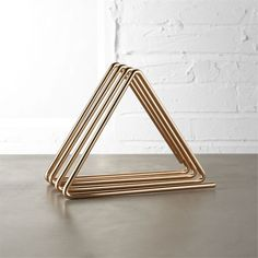 Shop gilded gold file holder.   Four shiny triangles hold files, notes, tablets—you name it.  A simple, elegant storage solution for your workspace, home or office.