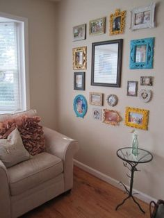 DIY Picture frame wall -- Love how the colors pop around the neutrals of the room.