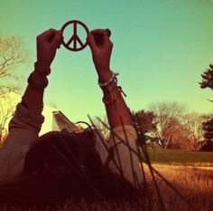 I have a huge sixties-esque peace sign charm from a necklace I could use for this! ☮