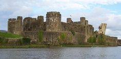Caerphilly Castle in Wales, stronghold of Hugh le Despenser, Lord Despenser.  It was originally constructed by Hugh's father-in-law, Gilbert de Clare.